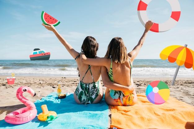 Meninas na praia com filtro de objetos de ícone
