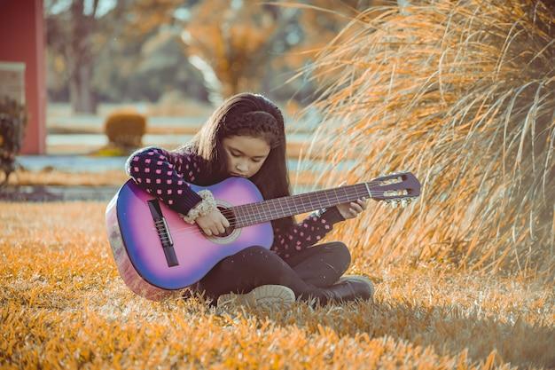 Menininha, violão jogo
