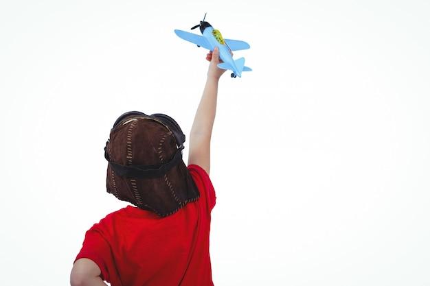 Menino, tocando, com, avião brinquedo