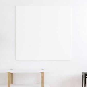 Mesa branca e tela vazia na parede