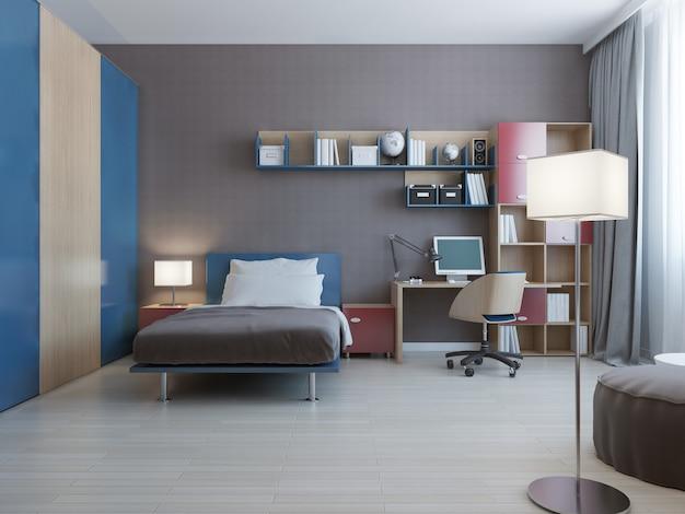 Mesa com sistema de parede em quarto moderno com sistema de parede nas cores azul e vermelho e cama forrada com travesseiros e grande armário com portas de correr azuis.