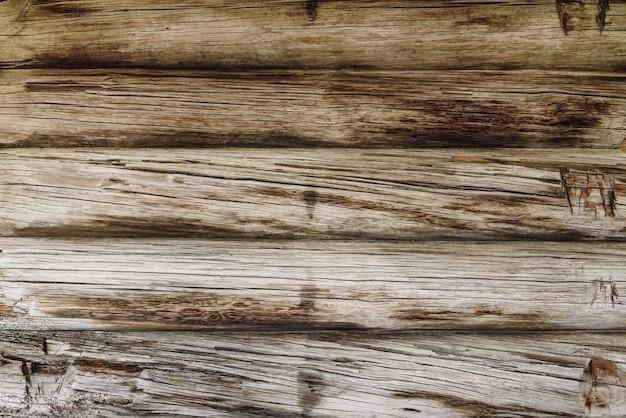 Mesa da parede de madeira velha e resistida.