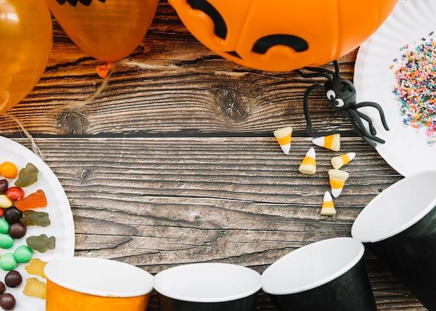 Mesa de halloween com balões e aranha