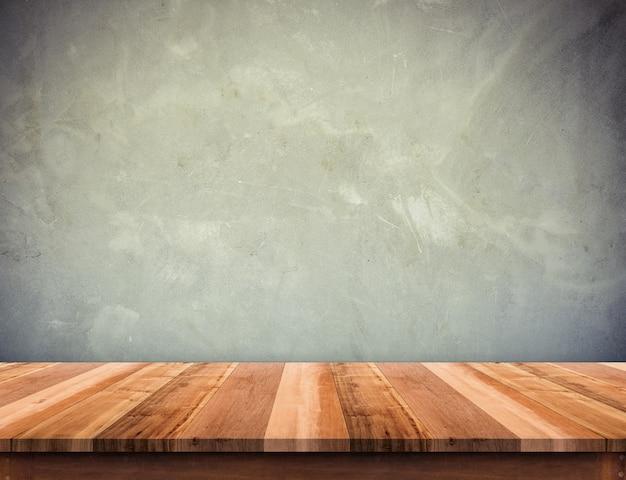 Mesa de madeira com parede de concreto de grunge, mock-se modelo para exibição ou montagem de produto