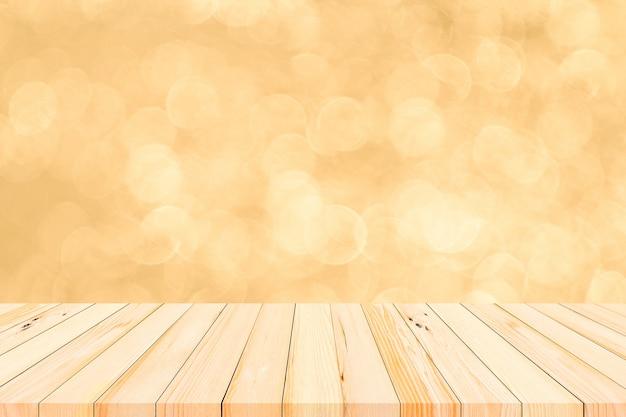 Mesa de madeira ou piso de madeira com bokeh abstrato dourado e fundo de fogos de artifício para exibição de produtos