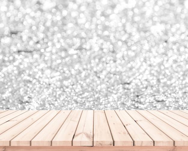Mesa de madeira ou piso de madeira com fundo abstrato branco bokeh para exposição do produto