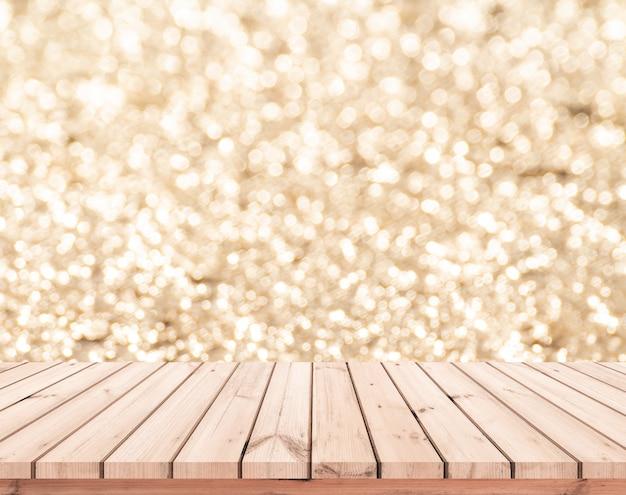 Mesa de madeira ou piso de madeira com fundo abstrato ouro bokeh para exposição do produto