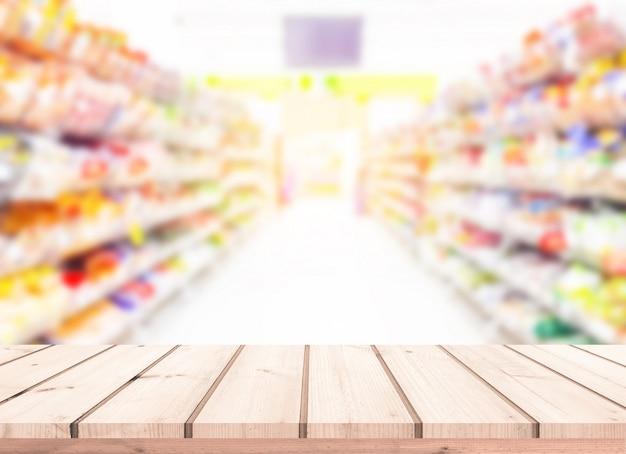 Mesa de madeira ou piso de madeira com supermercado desfocar o fundo para a exposição do produto
