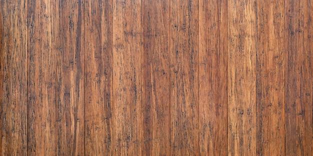 Mesa de madeira rústica com superfície vintage, fundo de pranchas marrons