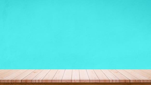 Mesa de madeira vazia com parede azul celeste