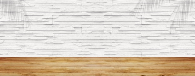 Mesa de madeira vazia com parede de pedra branca