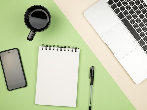 Mesa de mesa de escritório moderno com laptop, página de caderno em branco