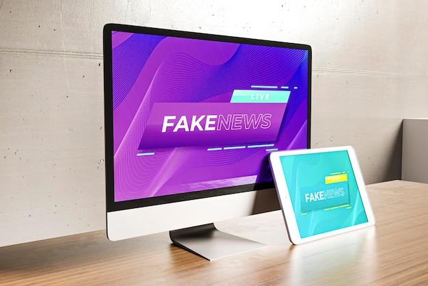 Mesa de trabalho com tablet e computador com notícias falsas