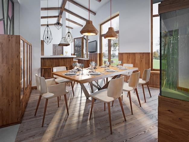 Mesa servida para oito pessoas na sala de jantar do loft com pé-direito alto