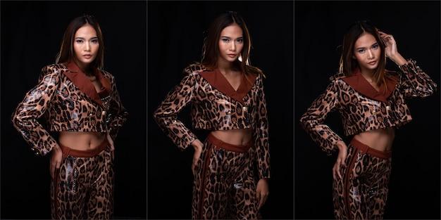 Metade do corpo do retrato de mulher asiática jovem pele bronzeada alta costura usa vestido padrão de pele de cobra. fundo preto da iluminação do estúdio isolado, conceito de pacote de grupo de colagem