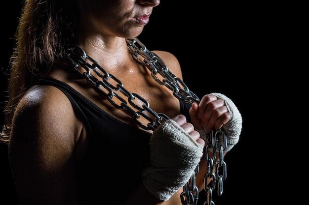 Midsection da cadeia de retenção de atleta feminino