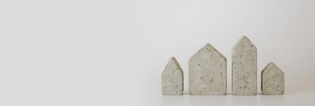 Mini casas de concreto no fundo branco. compre uma casa. conceito de escada de propriedade, hipoteca e investimento imobiliário. espaço livre para texto, cópia espaço, layout moderno.