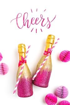 Mini garrafas individuais pink e gold para brindar champanhe com confete e enfeites de natal.