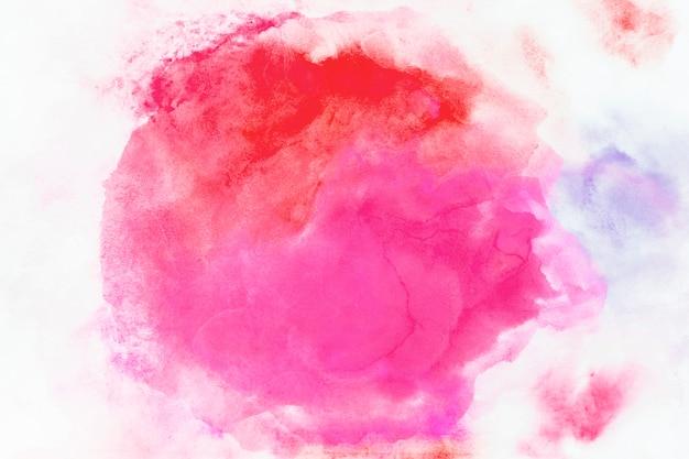 Mistura de aquarela vermelha e fúcsia