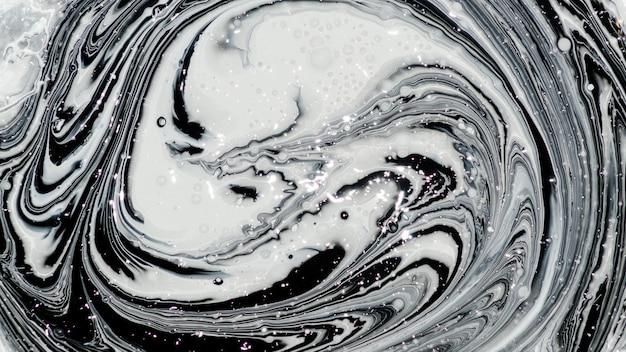 Mistura de imagem abstrata de duas cores. a textura dos círculos de tinta branca e preta