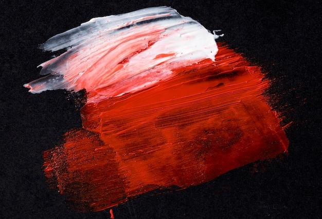 Mistura de tinta branca e vermelha