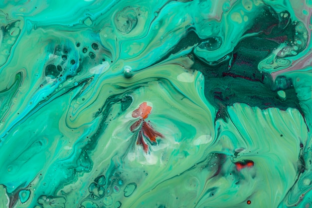 Mistura de verde e azul da textura artística de tinta acrílica