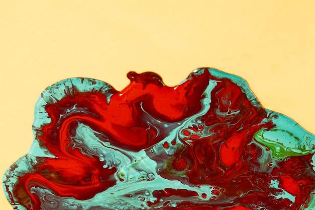 Mistura plana de tinta vermelha e verde