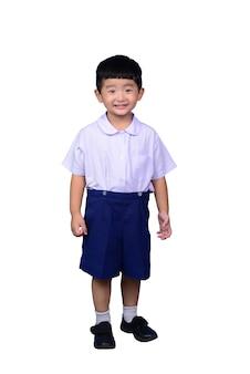 Miúdo asiático do estudante na farda da escola isolada com trajeto de grampeamento.