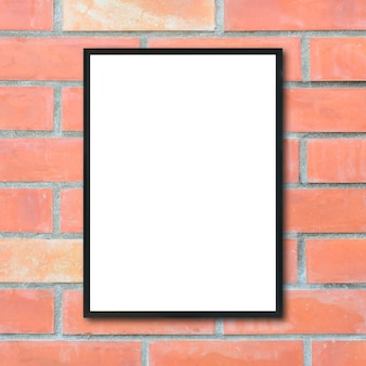 Mock up blank picture frame na parede de tijolos.