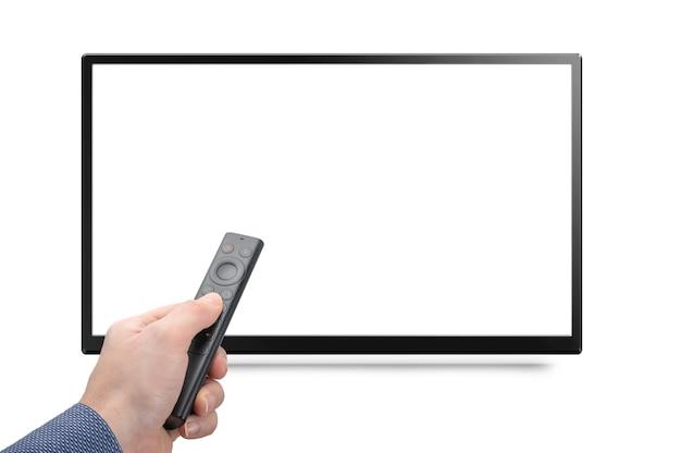 Mockup tv e mão com controle remoto moderno de uma caixa de mídia online isolada no fundo branco. tv 8k 4k com controle remoto na mão. maquete de monitor de tela branca em branco