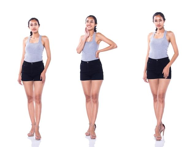 Moda jovem bronzeado pele 20 anos mulher asiática cinza vestido vasto curto calça preta sapatos de salto alto posar olhar de perfil atraente. iluminação do estúdio branco fundo isolado colagem pacote de grupo comprimento total