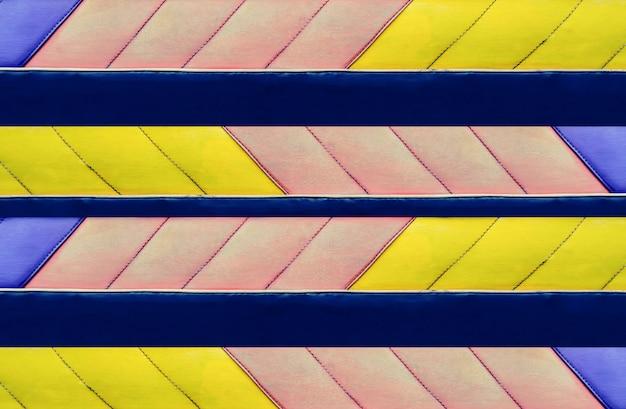 Modelo abstrato de couro colorido azul, rosa e amarelo, fundo de desenho de bandeira