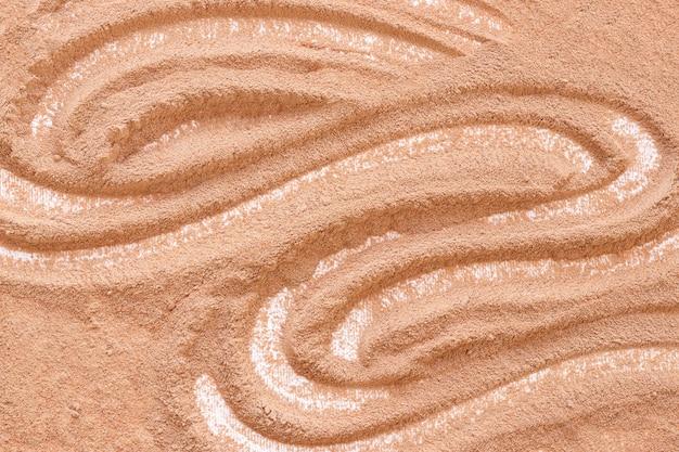 Modelo abstrato em vista alta da areia