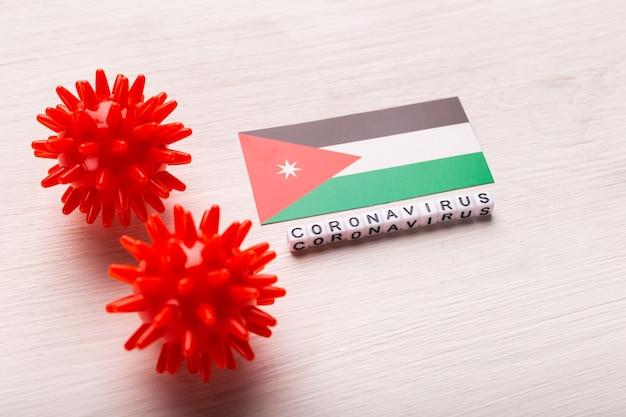 Modelo de cepa de vírus abstrato de coronavírus da síndrome respiratória do oriente médio 2019-ncov ou coronavírus covid-19 com texto e bandeira jordan em branco