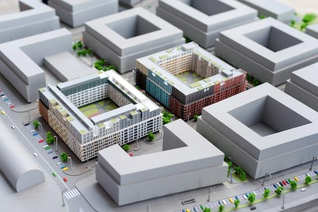 Modelo em miniatura, edifícios de brinquedos em miniatura, carros e pessoas. maquilhagem da cidade. novo projeto de construção