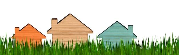 Modelos de casas de diferentes cores em um fundo de grama verde. fundo isolado. conceito de publicidade imobiliária. comprando, vendendo, alugando uma casa. hipoteca. copie o espaço. formato do banner.