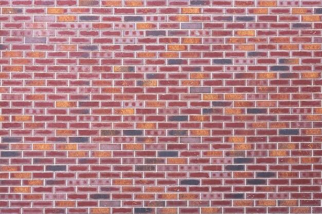 Moderna textura de parede colorida de tijolo vermelho mock up extreme closeup