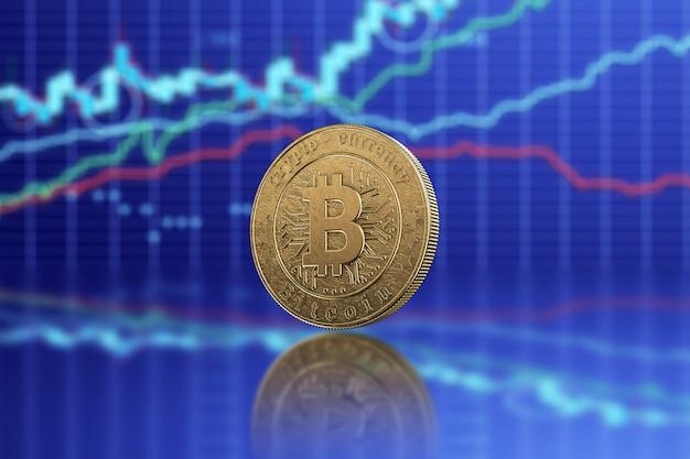 Moeda de ouro bitcoin em um fundo de tecnologia de gráficos de negócios.
