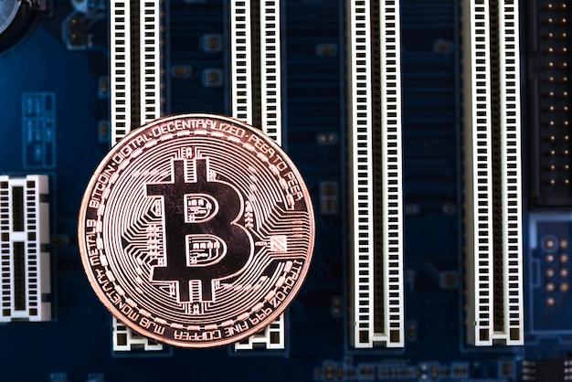 Moeda digital bitcoin na placa-mãe