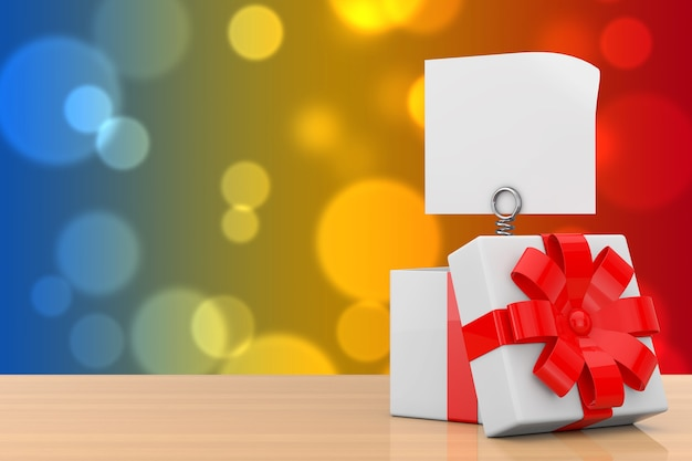 Mola de metal com papel banner em branco sai da caixa de presente com fita vermelha em uma mesa de madeira. renderização 3d
