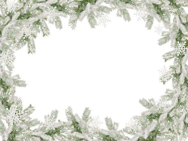 Moldura da árvore de natal coberta de neve para cartão de natal