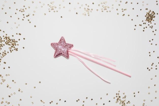 Moldura de confete dourado e estrela na vara