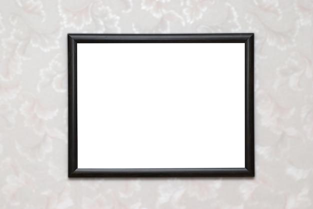 Moldura de foto vazia preta em branco isolada na parede branca