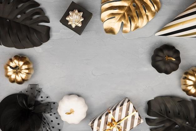 Moldura de halloween moderna com abóboras decorativas brilhantes douradas