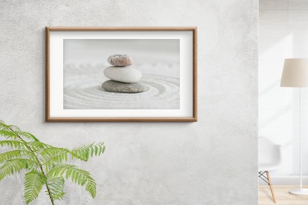 Moldura de madeira com foto de pedras zen no conceito de interior da parede