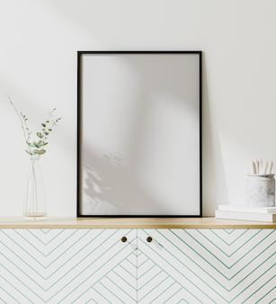 Moldura de pôster simulada em um interior moderno com parede branca, estilo escandinavo, renderização em 3d