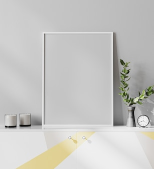 Moldura de pôster simulada em um interior moderno e minimalista em estilo escandinavo com parede cinza claro, armário de cor amarela e cinza, renderização em 3d