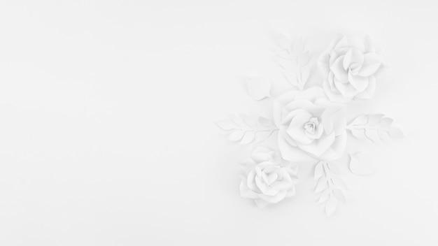 Moldura de vista superior com flores de papel branco e fundo