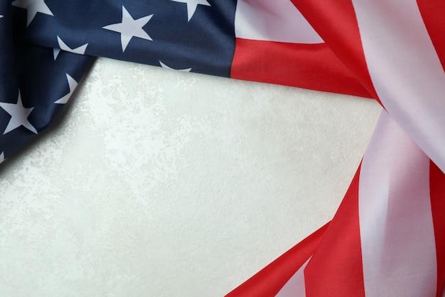 Moldura feita de bandeira americana em plano de fundo texturizado branco