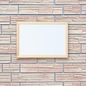 Moldura para fotos de madeira vazia pendurada em uma parede de tijolos. fundo, local para montar seu objeto.